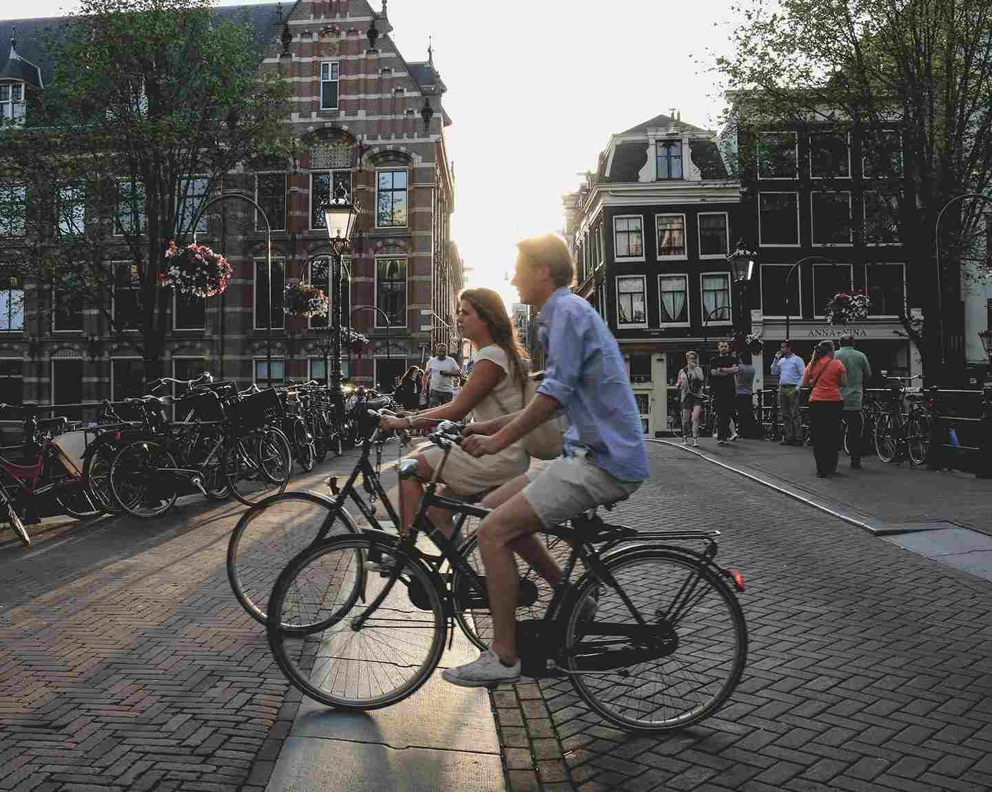 A couple riding a bicycle in Jordaan