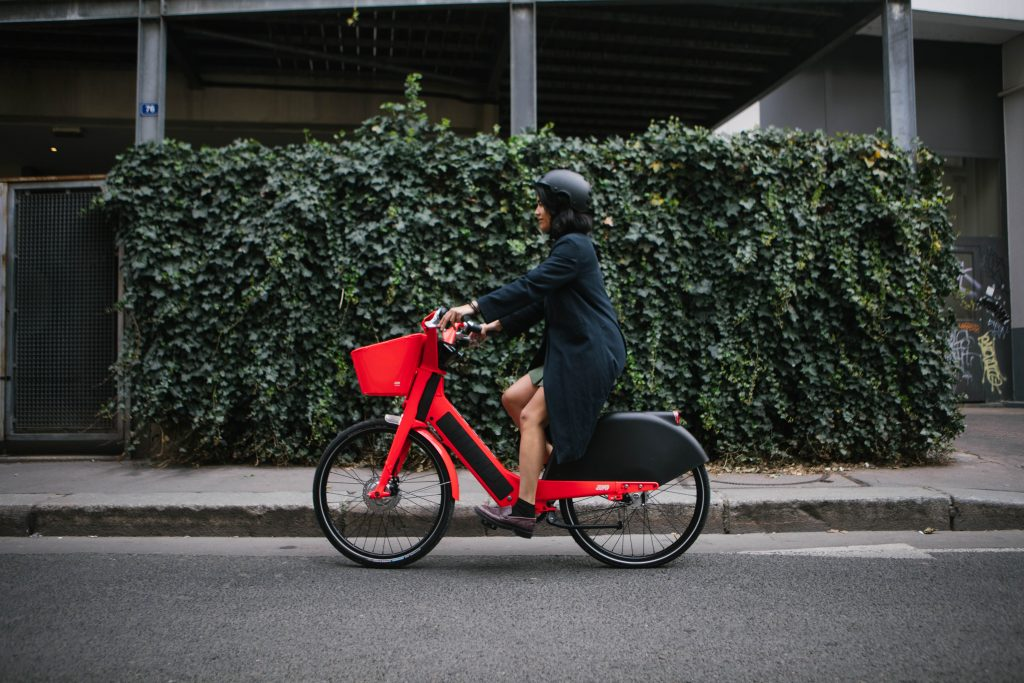 Woman following main cycling rules of the road
