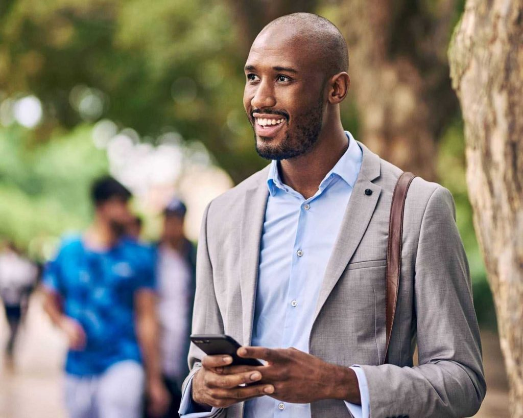 men in park requesting a ride in his phone