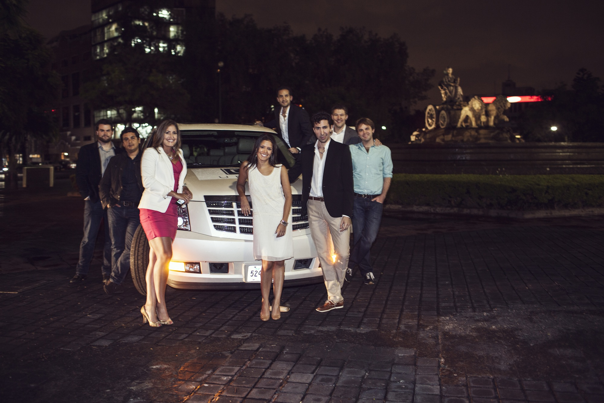 Uber Team w_ Escalade and Fountain
